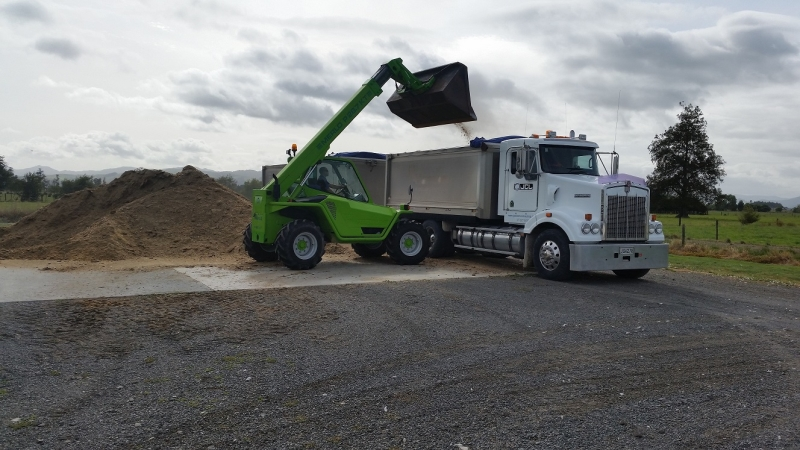 Loading Kenworth Truck and Trailer with Chicken Litter